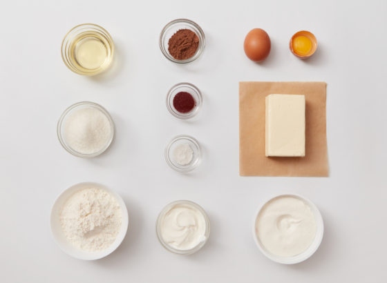 Top view of different ingredients for baking or cooking represented separately over white background. Ingredients for cooking cakes or breads.
